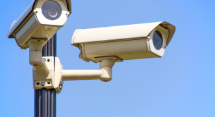 Surveillance cameras keep watch over an audit